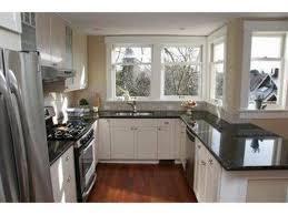 black kitchen cabinets and granite countertops interior