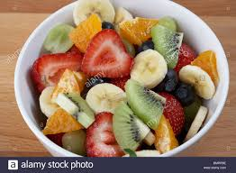 bowl of mixed fruit salad for a healthy breakfast stock photo