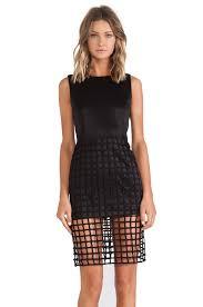 kim kardashian squeezes herself into racy see through cage dress