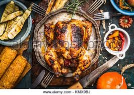 thanksgiving day food roasted whole chicken or turkey on