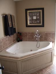 love this corner tub with board and batten beach coastal bathroom