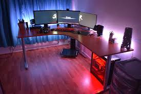 photo of triple monitor desk setup with cool gaming computer desk