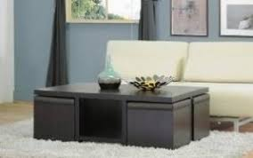 coffee table with ottomans underneath open travel