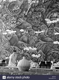 murals painted on the walls of a dining room on georgian artist