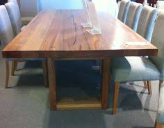 Dining Room Furniture Melbourne - custom dining table with waterfall breadboard ends made by bombora