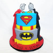 batman vs superman cake for twin boys celebrating their first