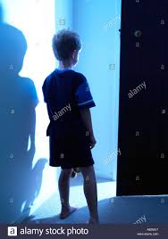 Inhouse Child Walking In House At Night Going Towards A Blue Light With