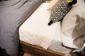 the proper way to make a bed these tricks will make your bed look like a dreamy store display