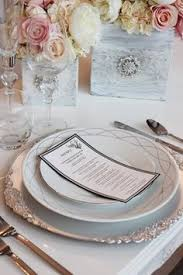 silver wedding plates table set up with burlap runner and silver charger plate table