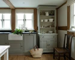 country grey kitchen cabinets with black countertop featuring