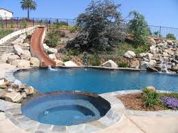 awesome backyard pools swimming pool slide on the hill slopes boulders outdoors