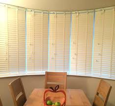 dining room bay window window blinds bay window blind solutions white wooden blinds for