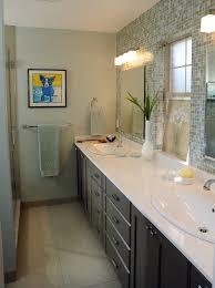 impressive mirrored tile backsplash with herringbone pattern pivot