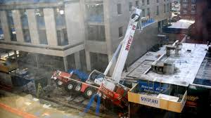 cops operator left with minor injuries in crane collapse at
