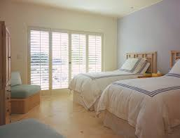Plantation Blinds Cost Plantation Shutters Cost Bedroom Tropical With Accent Wall Armoire