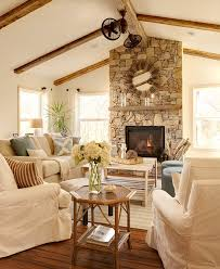 vaulted ceiling with wood beams natural stone fireplace and