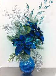 this christmas arrangement is in peacock blue christmas decor