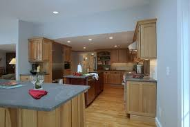 cape and island kitchens jet mist granite for a farmhouse kitchen with a white kitchen