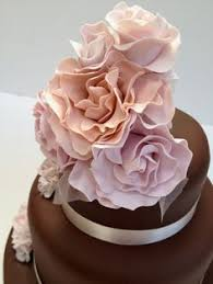 swirls of chocolate wedding cake by intricate icings cake design