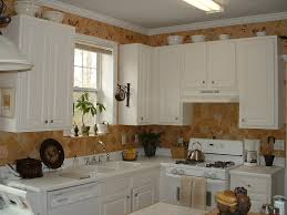 ideas for decorating above kitchen cabinets black stove dark