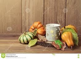 Thanksgiving Pumpkin Decorations Autumn Wallpaper With Candle Pumpkin Decorations And Fall Leaves