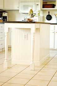 get tutorial of diy kitchen island images from dated to darling an amazing kitchen island transformation