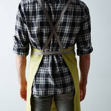 fern green cross back kitchen apron with slate ties on food52