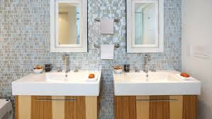 white shaker vanity cabinets with gray glass tile backsplash