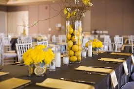 captivating yellow and black wedding table decoration using really