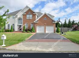 suburban two car garage blacktop driveway stock photo 94016209