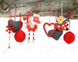 christmas ornaments hanging on a wooden background stock photo