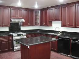 kitchen green granite dark cherry cabinets