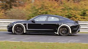 old hatchback porsche porsche mission e spied cornering hard on the nürburgring