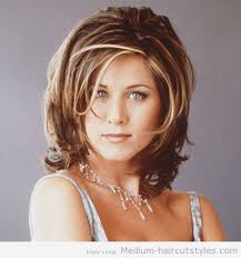 medium length hairstyles for thick hair for women over 50 2