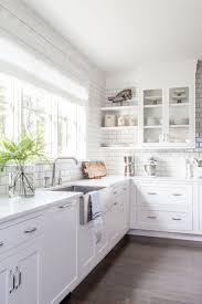 kitchen window shades with white subway tile backsplash also