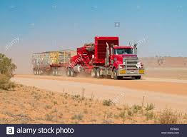 semi trailer truck road train huge red semi trailer truck loaded with mining stock