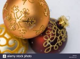three decorations baubles decorated with gold stock