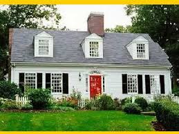 cape cod house style a cape cod style with door and black shutters home
