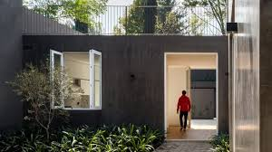 two house dcpp arranges walled mexico city house around two courtyards
