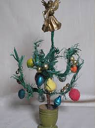 dollhouse feather christmas tree decorated with glass bulbs