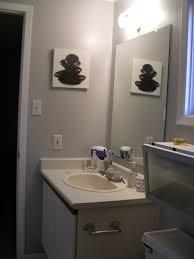 classic single sink vanity mirror with simple lighting design