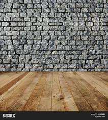 old grey square brick wall and wooden floor stock photo loversiq