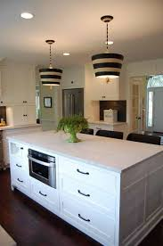 kitchen island with hidden paper towel holder and microwave oven