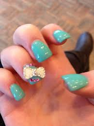 tiffany blue acrylic gel nails with pink rhinestones and a white