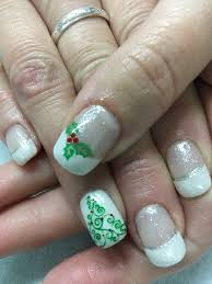 simple white french christmas tree and holly sparkle gel nails