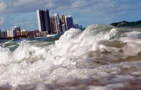 how fast and how far will sea levels rise yale e360