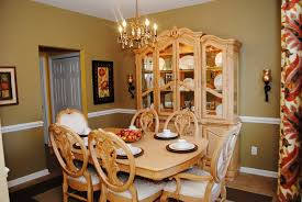 traditional formal dining room with earth tone wall paint color