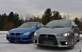 mitsubishi evo jekyll u0026 hyde bmw 335i xdrive vs mitsubishi evo mr u2013 limited