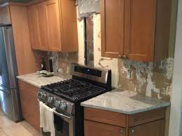 how to cut tile around cabinets how to install a tile backsplash monk s home improvements