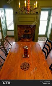 colonial style home interior dining room with fireplace stock